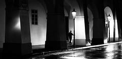 La nuit solitaire (One_Penny) Tags: street city travel light boy urban blackandwhite white man black building lamp rain architecture night contrast reflections dark walking photography town alone arch prague prag praha tschechien czechrepublic lonely noire canon6d