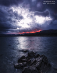 Fire and water (Carlos Snchez Santos - Deep Blue Fotografa) Tags: madrid longexposure winter sunset sun snow storm mountains sol nature water clouds canon landscape atardecer spain agua dam paisaje nubes invierno puestadesol embalse largaexposicion