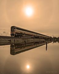 Hidden Horizon (GeorgeTsai 168) Tags: railroad sky cloud sun reflection water train solar horizon halo symmetry hidden
