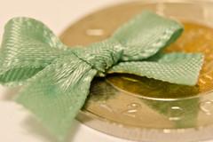 Mint (L E Dye) Tags: canada nikon alberta bow ribbon toonie twodollarcoin macromonday d5100 extentiontube36mm ledye may23smallerthanacoin