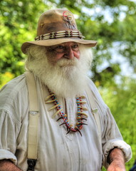 Fur Trapper (Tom Mortenson) Tags: bearclaws character furtrapper outdoor wisconsin midwest usa northamerica america canon digital littlebullfalls logjamfestival mosinee centralwisconsin beard summer portrait 24105l canoneos canon6d bearclawnecklace geotagged costume reenactment encampment voyager reenactor historical pioneer festival riverpark