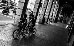Giro d'Italia (damar47) Tags: street city shadow people blackandwhite italy cars monochrome kids youth vanishingpoint italia shadows traffic pentax citylife streetphotography bikes monochromatic ombre bologna bici citycenter portici arcs biancoenero colonnade portico biciclette streetstyle stazionedibologna pentaxart pentaxk30