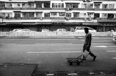 (David Davidoff) Tags: life street city people urban walking blackwhite geometry candid moment oldbuilding leicaflexsl2 fomafilm fomapanprofilineaction400 elmaritr28mmf28