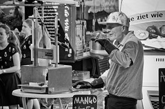 The Pineapple Man (Alfred Grupstra Photography) Tags: street people blackandwhite bw man haarlem women market nederland streetphotography streetlife nl noordholland