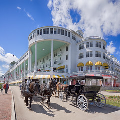 _DSC3241 The Grand Hotel (Charles Bonham) Tags: flowers horse architecture hotel carriage outdoor americanflag geraniums lilacfestival frontporch mackinacisland horsedrawncarriage straitsofmackinac drafthorses thegrandhotel michiganupperpeninsula summerhotel horsetransportation charlesbonhamphotography