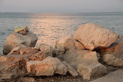 Towel On The Rocks (Alan1954) Tags: piran slovenia holiday 2016 sunset towel sea rocks