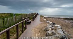 Bank Hoilday (dwryan1979) Tags: ocean pink sea sky beach rain weather clouds landscape bay spring sand rocks wind seat bank rainclouds porthcawl hoilday