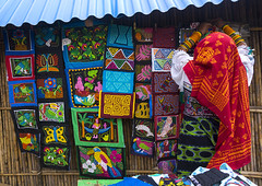 Panama, San Blas Islands, Mamitupu, Kuna Woman In Traditional Outfits Selling Colorful Hand Stitched Kuna Indian Molas (Eric Lafforgue) Tags: original detail tourism latinamerica horizontal handicraft photography islands community folkart day pattern needlework stitch market native embroidery patterns crafts indian traditional country culture craft nobody nopeople tribal souvenir textile exotic fabric cotton needle panama dailylife typical tribe peddle sell selling vacations embroidered handstitched stylized cultural kuna mola archipelago indigenous yala sewn ethnicity panamanian ecotourism indigenouspeople cuna crafted guna embroider traveldestinations kunas sanblasislands kunna unrecognizableperson mamitupu embroideredtextile artandcraftcolourful panama210