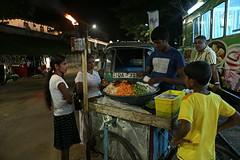 street food 2 kelaniya (Himash De Silva) Tags: street light boy people food ice night truck canon temple fire eos is yummy women waiting looking low cream tasty srilanka usm f28 6d kelaniya ef24mm rajamahaviharaya