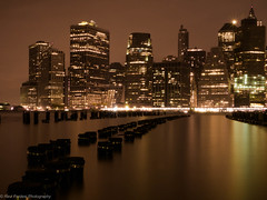 Majestic Downtown, NYC (ravi_pardesi) Tags: nyc newyorkcity longexposure nightphotography ny newyork art beautiful skyline architecture night composition america docks gold amazing downtown gorgeous dumbo financial longshutter eastcoast awesomeness skyscrapper picoftheday