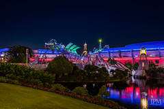 Looking forward to tomorrow (JPMulhearn) Tags: neon longexposure night disney water reflections colorful tomorrow tomorowland park magickingdom magic disneypictures disneypics disneyphotos waltdisney color nikon d750