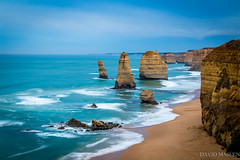 The Twelve Apostles (David Maslen) Tags: ocean blue cliff seascape beach nature water sunrise canon landscape coast rocks aqua waves natural rocky australia victoria greatoceanroad twelveapostles turqoise movingwater rockstacks canon6d