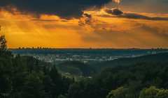Last rays of the day. (grace.morgan100) Tags: trees sky forest city sunset color sun buildings clouds cityscape summer evening skyline rays panoramic colorful colorimage vilnius lithuania