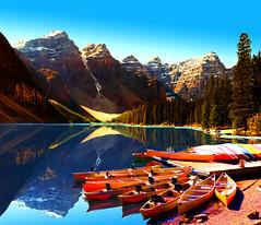 111 MORAINE LAKE CANOE REFLECTION MED (Gerry Slabaugh) Tags: lake canoes alberta moraine canadianrockies gerryslabaugh