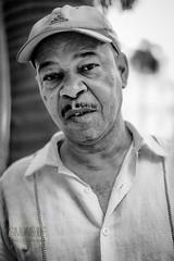 Ernesto (Simone Della Fornace) Tags: portrait blackandwhite white man black monochrome face zeiss person sony cuba culture documentary cuban bianco nero biancoenero oneperson reportage a7rii