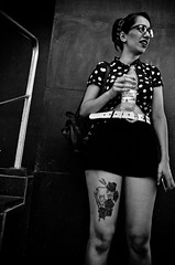 My Life, My Style (stimpsonjake) Tags: nikoncoolpixa 185mm streetphotography bucharest romania city candid blackandwhite bw monochrome style funky cool girl woman glasses tattoo shorts