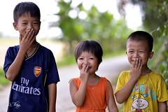 Hiding smile (Le.Thang) Tags: