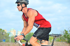 Danny Maher (Chris Hunkeler) Tags: male wet bike tattoo standing marine cyclist sandiego danny tanktop omalley strong biker shorts athlete upright donny triathlon fit confident maher exmilitary koz ashirt 1438 springsprint dannymaher bullettattoo kozevents bib1438 donnyomalley bulletstattoo