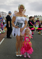 100801.125. Big Fairy, Little Fairy.  (THDS010810carnival-33.) (actionsnaps) Tags: uk pink costumes woman girl smiling female kent wings child adult daughter mother free lifestyle parade mum dressingup leisure familyfun procession flyers fancydress margate sleepingbeauty suckingthumb dayout wintergardens thanet familyevent leaflets publicevent communityevent littlefairy verticalimage bigfairy portraitformat annualevent margatecarnival fairycostumes openairentertainment margateoperaticsociety