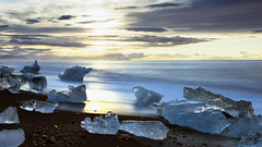 walking amidst millenial ice sculptures (lunaryuna (off to Iceland for 2 weeks)) Tags: longexposure sky seascape cold clouds sunrise landscape dawn coast iceland ngc shoreline le icefloes lunaryuna cloudscape northatlantic southiceland diamondbay glacialice lightmood thecoloursofcold jokulsarlonglacierlake earlybirdexperience thesediamondsarenotforever