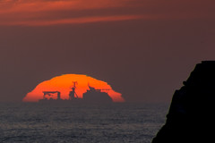 Passing Ship (Evoljo) Tags: sunset red sky water silhouette evening nikon cornwall ship godrevy d7100