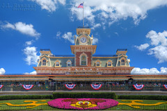 Magic Kingdom Main Street Railroad Station (J.L. Ramsaur Photography) Tags: flowers sky clouds vintage photography photo nikon florida landscaping americanflag bluesky pic patriotic disney mickey disneyworld photograph mickeymouse thesouth orangecounty waltdisneyworld magical starsandstripes magickingdom redwhiteblue usflag waltdisney oldglory mainstreetusa whiteclouds centralflorida beautifulsky happiestplaceonearth 2016 imagineering lakebuenavistafl deepbluesky waltdisneyworldresort skyabove vintagebuilding wheredreamscometrue waltdisneyworldrailroad disneyrailroad retrobuilding classicbuilding ibeauty antiquebuilding allskyandclouds tennesseephotographer southernphotography screamofthephotographer flowermickey jlrphotography photographyforgod disneysmagickingdom mainstreetrailroadstation d7200 engineerswithcameras jlramsaurphotography nikond7200 patrioticproud magickingdommainstreetrailroadstation mickeyinflowers