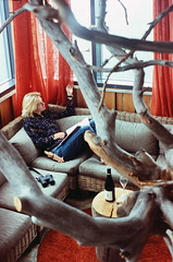 In Iso-Syote`s Eagle suite Hotel, Northern Finland (Iurii & Natali) Tags: ispsyote iso syote national park mountain eagle suite hotel room wood design tree red wooden girl gant portrait wine film ektar kodak 50mm m42 vintage analogue classic nice mood praktica