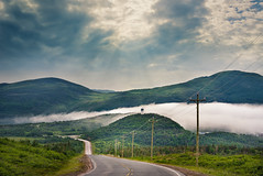 Fog over Trout River (Tracy Munson Photography) Tags: road travel sky mist canada mountains tourism nature weather fog clouds newfoundland landscape nationalpark seaside atlantic nl sunrays grosmorne eastcoast troutriver
