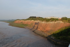 Red Cliffs of England (sgreen757) Tags: old uk bridge original sunset shadow red england cliff beach river fuji crossing motorway south first cliffs gloucestershire estuary severn fujifilm services x30 glos aust m48