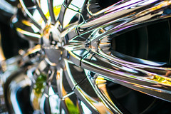 Wheel. Well well well. (pillarsoflight) Tags: pink black reflection green colors beauty yellow oregon sedan silver portland prime aperture nikon colorful dof purple wheels chrome adobe pdx chrysler custom 18 35 pnw lightroom aftermarket customwheels wide d3300 aperture