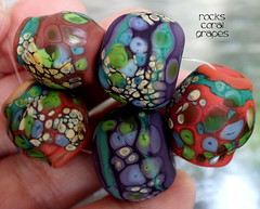 Rocks Coral Grapes (Laura Blanck Openstudio) Tags: show blue red etched orange usa abstract brick green art glass coral festival set beads sand rocks colorful published artist glow purple handmade stones eggplant teal maroon fine arts violet plum sienna funky jewelry pebbles made odd earthy mango winner mauve opaque bead mermaid nuggets murano grape lampwork multicolor raku artisan matte whimsical loose frit openstudio asymmetric ocher speckles openstudiobeads