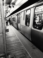 a Red line night (williamw60640) Tags: chicago elevatedtrainstation elevatedtrain chicagotransitauthority passengers publictransit commuters blackandwhite urbanscenes cityscenes trainplatform