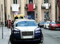 Social divide - Austerity Britain (fleeting glimpse2009) Tags: urban car britain homeless rich rollsroyce social wealth austerity loveactivists