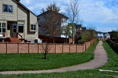 Spaces Inbetween (Pedestrian Photographer) Tags: trees houses homes sky green clouds spring colorado suburban lawn may fences neighborhood trail springs co walls cos springtime between greenway ribbet 2016 dsc1811 dsc1811b