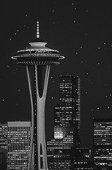 Focus on Space Needle with downtown buildings with sunset light  and star fields (Jim Corwin's PhotoStream) Tags: travel tourism vertical architecture sunrise buildings outdoors photography twilight downtown nw cityscape skyscrapers photoshopped sightseeing skylines officebuildings timeexposure pacificnorthwest spaceneedle local attractions exteriors destinations urbanscene compositeimage famousplace placestosee nationallandmark