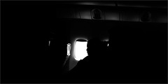 ... black and white ... (upon awakening) (Fede Falces ( ...... )) Tags: blackandwhite bw window girl silhouette canon airplane travels awakening noiretblanc stones interior profile flight rollingstones paintitblack g15