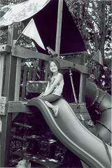 Rylee on the slide (Stephen Hilton) Tags: bw blackwhite fp4 canonetgiiiql17