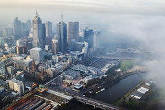 Fog rolling over Melbourne (Kokkai Ng) Tags: fog rolling over melbourne victoria australia winter city cbd cityscape skyline autumn cold elevatedview highup victoriastate sullen dark surveillance dusk sunset cloud traveldestinations travel tourism famousplace financialdistrict downtown horizontal river riveryarra federationsquare officeblock skyscraper builtstructure buildingexterior flindersstreetstation blue overcast weather nature