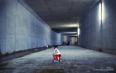 Child in tunnel (John.Klaver) Tags: california wedding light portrait people holland color building art beach sports water dutch fashion animals rock architecture photoshop canon children landscape concrete photography licht photo construction focus foto fotografie documentary picasa tunnel penn 1968 fotografia dijk portret alkmaar mode dike cartierbresson hollands newton magnum architectuur avedon landschap facebook mensen kleur panl diafragma sanoma klaver panoramio nufoto autonome cs5 digifoto autonoom fotoacademie lumiance nikond300 photoq nikond800 johnklaver maxbogl