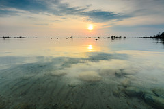 Mission Point Alchemy (Aaron Springer) Tags: sun reflection nature water rock sunrise landscape outdoor michigan lakemichigan lakeshore serene eastbay traversecity northernmichigan oldmissionpoint oldmissionpeninsula thegreatlakes
