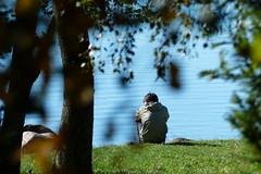 Alone (evisdotter) Tags: alone beach trees boy man water leaves bokeh sooc nature
