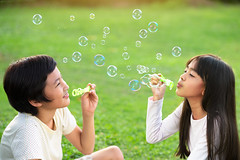 Blowing soap bubbles (Patrick Foto ;)) Tags: park friends boy summer two portrait people playing game cute male green nature girl beautiful childhood kids children asian fun thailand outside happy person freedom kid soap pretty chil