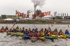 Small 800px Water is Sacred during Indigenous Day Flotilla at Break Free PNW 2016 Photo taken by John Duffy 27104327905_dac087b675_c (Backbone Campaign) Tags: water justice washington energy kayak break action politics protest creative paddle shell free social demonstration oil change wa environment activism anacortes campaign pnw refinery climatechange climate tesoro artful backbone renewable refineries 2016 kayaktivist kayaktivism breakfreepnw