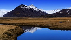 pristine landscapes barely touched by man (lunaryuna) Tags: light snow ice nature water beauty weather reflections river season landscape iceland spring solitude lunaryuna stillness mountainrange snowcappedmountains boggrass seasonalchange southeasticeland lightmood pristinelandscape