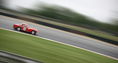 Triumph (V Photography and Art) Tags: orange blur car speed vintage track triumph panning carracing recetrack