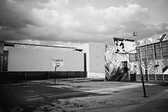 R2-E057 (David Swift Photography Thanks for 16 million view) Tags: film philadelphia playground basketball 35mm westphiladelphia murals schools hoops ilfordxp2 deserted basketballcourt yashicat4 schoolplayground davidswiftphotography