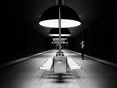 in thought (Sandy...J) Tags: street city light urban bw white man lines station silhouette germany dark underground walking munich mnchen deutschland photography mono licht noir fotografie darkness metro walk streetphotography olympus stadt ubahn sw mann monochrom passage gehen dunkelheit linien schwarzweis strasenfotografie