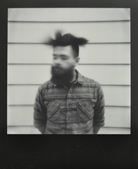 It's All a Blur (H o l l y.) Tags: impossible project polaroid black frame bw white no color boy movement action hair beard man flannel fashion retro indie vintage
