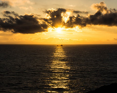 Iluminado  - ( explore ) (MaryPazSL) Tags: contraluz barco asturias salinas explore nubes silueta naranja cantabrico