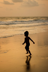 """""""Smell the Sea and feel the Sky... Let your Soul and Spirit Fly"""" (Pattugrapher) Tags: sunset sea reflection beach water pose fun golden kid sand waves play goa silhouettes son run enjoy"""